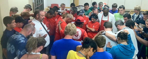 Emergency volunteers prayer circle. Credit: Chris Farrand, The Salvation Army